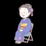 青い着物を着て座っている成人女性