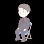 黒いスーツを着て座っている成人男性