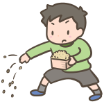 豆まきをする男の子