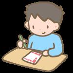 年賀状を書く男の子
