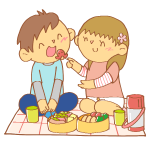 ピクニックでお弁当を食べる男女