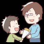 お父さんに花をあげる男の子