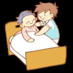 ベッドで介助をする男性介護士