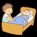 ベッドを整える男性介護士