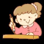 書道をする女の子
