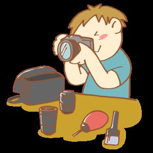 カメラを手入れしている男性