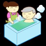 入浴介助の女性とおばあさん