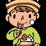 誕生日ケーキを食べる男の子