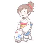 白い着物を着て座っている成人女性