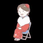 赤い着物を着て座っている成人女性
