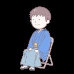 青い袴を着て座っている成人男性