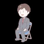 灰色のスーツを着て座っている成人男性