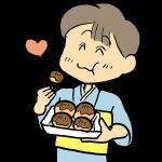 たこ焼きを食べている男の子