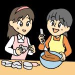 チョコレート作りをする娘と母