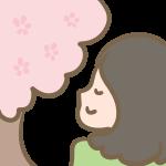 桜に癒される女性