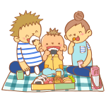 ピクニックでお弁当を食べる家族