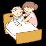 ベッドで介助をする女性介護士