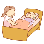 ベッドを整える女性介護士