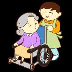 車いすのお婆さんと男性スタッフ(笑顔)