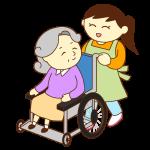 車いすのお婆さんと女性スタッフ(笑顔)